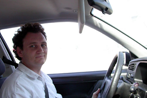 nick in his car